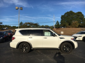 17-armada-platinum-4x4-pearl-white-beige-almond-cloth-captains-chairs-nissan-of-lagrange-atlanta-columbus-newnan-4