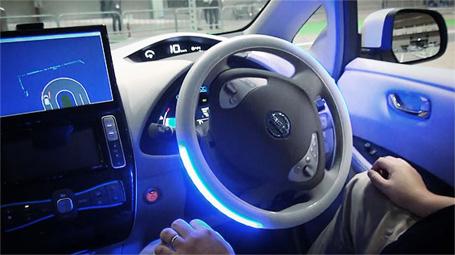 "Nissan CEO Carlos Ghosn""drives"" an Infiniti Autonomous DrivingVehicle"